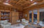 Wood paneled library with private courtyard
