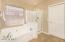 Separate tub & shower plus large closet!