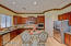 Kitchen features granite counters and stainless steel appliances. Large island and built in desk space as well.