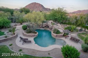 Privacy and Mountain Views. Enjoy a resort like backyard with oversized pool, spa, fireplace, firepit, putting green, and built-in BBQ.
