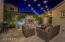 Not a detail was missed in this courtyard, w/ bistro lights, travertine hardscape, gas fireplace and water features.