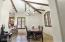 Vaulted ceiling and dramatic beams and lighting