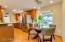 Breakfast Room with Bay Window & Custom Pendant Lighting