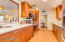 Spacious Kitchen with Recessed Lighting, Pendants over Bar & Samsung French Door Refrigerator (conveys)