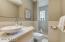Bright Hall Bathroom with Walk-In Shower