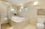 Oversized Jetted Tub that recirculates with Fresh Water & Separate Teak Floor/Tiled Shower-Thermostatically Controlled Faucet