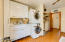Laundry Room with Ceiling Fan & Hardwood Doors. (Washer & Dryer Convey)