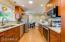 Open & Bright Kitchen w/Corian Counters & Soft Close Cabinetry