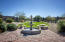 Immaculately kept grounds with picnic tables/ fountain/grassy area