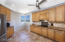 Tons of cabinets in this spacious kitchen & breakfast nook overlooking the North mountains