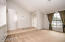 Your grand entry way and large, light sunken living room