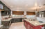 Stainless steel appliances (gas stove), granite countertops and custom window treatments