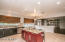 Cooking for the family or a large get together is easily a group effort with plenty of room for everyone in your large, open concept kitchen