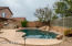 Heated pebble tech style - salt water pool with boulder waterfall