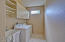 A hanging space, laundry tub and cabinets makes this a great inside laundry