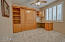 Second Bedroom has a nice large shuttered window and built-in Murphy Bed and desk area with a large flat closet