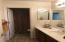 Featuring a tub w/shower and conveniently located close to secondary bedrooms.