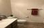 Main level bathroom convenient for family and visiting guests.