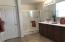 Master bath boasts dual sinks, double shower, linen closet, private commode.