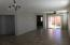 Spacious Great Room opens to covered patio and backyard. Easy access to community.