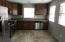 Mocha Maple cabinetry, stainless steel appliances, gas cooking and room for bistro table and chairs.