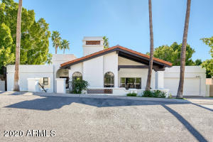 Hurry and schedule a tour of this gorgeous and contemporary Santa Barbara style retreat before it's gone! This home will make you'll feel like you've been transported to Southern California but the incredible views of Camelback Mountain remind you that you're still in the desert. The formal living and dining area features an open concept with smoked English oak floors and soaring, wood-beamed ceilings that offer a bright, airy feel. Multiple windows and patio doors frame breathtaking views of the mountain. The freshly redesigned kitchen features Carrara marble tiling, quartz counters, Viking appliances, and custom cabinetry. The backyard is perfect for entertaining and can be accessed from both master suites. Enjoy the sunset in your private, heated pool and spa.