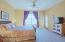 Large Master Bedroom with Access to Private Balcony and Mountain Views