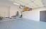 Two Car Garage offers Cabinets, a Large Storage Closet and Epoxy Floor