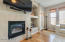 Living room features a gas fireplace and entertainment center