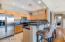 Beautiful, spacious kitchen with convenient breakfast bar
