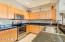 Kitchen features tons of cabinetry, beautiful granite tile counters, and gleaming stainless steel appliances