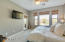 Master bedroom is light and open, with access to one of the two balconies