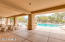 Covered poolside space to relax and entertain