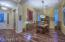 Entry with Custom Front Door with Key Pad, New Wood Flooring, & Formal Dining