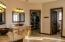 All new fixtures, copper sinks, copper bathtub, tile shower, new toilet, new interior doors, travertine floors, cabinets, closet organization.