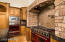 Viking appliances with 6-burner stove w/ grill, multiple ovens, warming drawer and microwave.