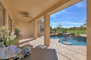 Covered Patio overlooking pool, firepit and golf course.