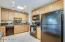 Enjoy gas cooking and the natural lighting in this spacious kitchen for all the chefs in your home to enjoy.