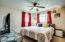 Ceiling fans and carpet in all three bedrooms.