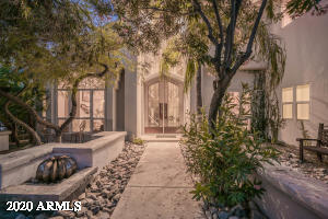 The entry features a custom leaded glass windows that provide both privacy and natural light Primary Image