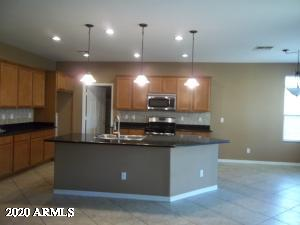 Granite, Stainless Appliances, Pendant Lighting and Expanded Cabinetry!