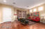 Open entrance into living and dining rooms with engineered hard wood flooring