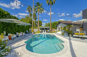 Palm Springs inspiration comes to life in this incredible resort backyard!
