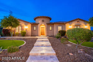 This single level luxury estate is nestled on a cul-de-sac lot neighboring the community park in a gated community
