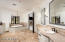 Master bath with dual vanities, tub, shower, dual water closets