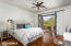 Bedroom suite with private patio, bath, walk-in closet