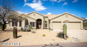 Corner lot, North/South exposure. Full desert landscaping front and back