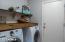 Laundry room with custom builtin shelf