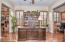 Versatile Den is split into 3 parts: bookcases, Den, & office area