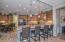 Large breakfast bar with granite slab countertops & pendant lights